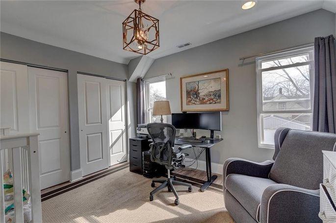 Bedroom/office/ nursery with brass light fixture