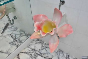 We Can't Stop Looking at the Flower Urinal in This Jersey Penthouse