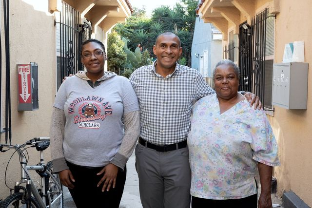 Martin Muoto, center, with tenants at a SoLa development in Los Angeles.