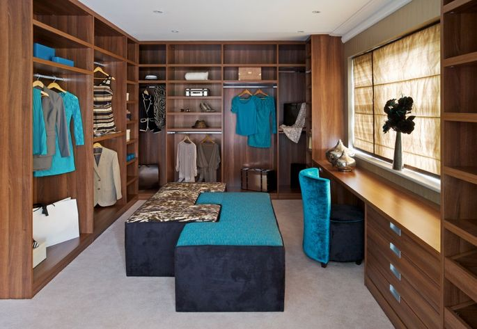 Ah, a glamorous walk-in closet where you'll sip wine and peruse your clothes. Not.