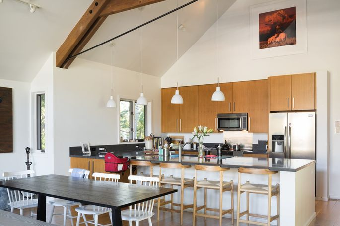 The kitchen is open to the dining area and has high ceilings.