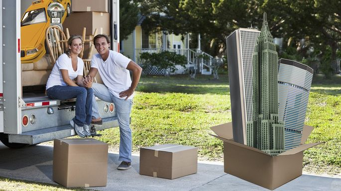 Young couple with moving truck