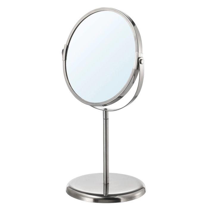 Avoid crowded communal bathrooms by using a desk mirror.