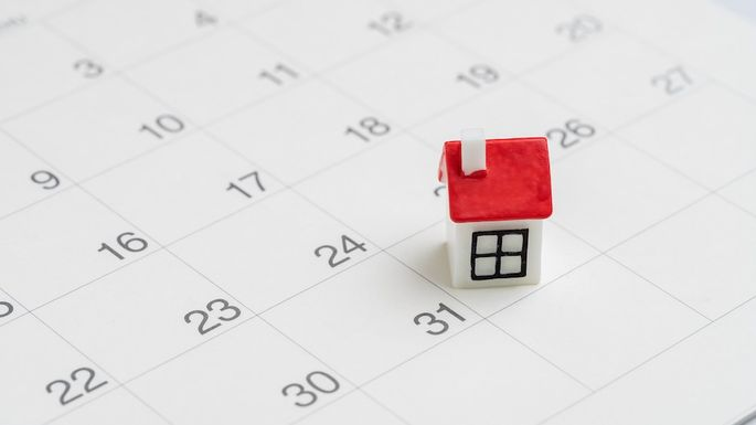 Housing, property or real estate or mortgage payment concept, miniature house with red roof on the end of month 31th date white clean calendar