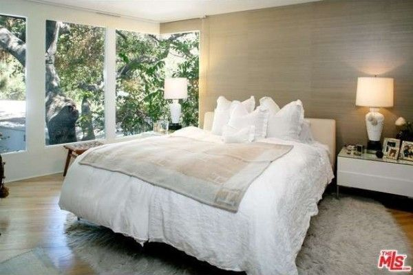 A natural color palette gives a cozy feel to the bedroom.