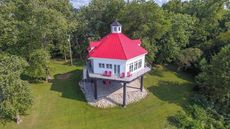 $779K Lighthouse-Inspired Home on the Ohio River Waiting To Guide In a Buyer