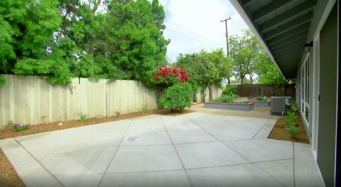 This yard looks much better with the new cement and greenery.