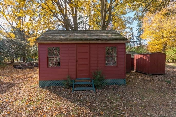 A playhouse is included with the sale.