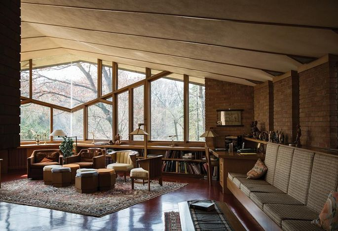 The Olferts' large living room features a dramatically angled ceiling. Wright hid structural supports in the window mullions.