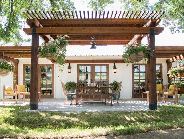 This gorgeous pergola covered patio didn't even exist before -- nor did the beautiful French doors