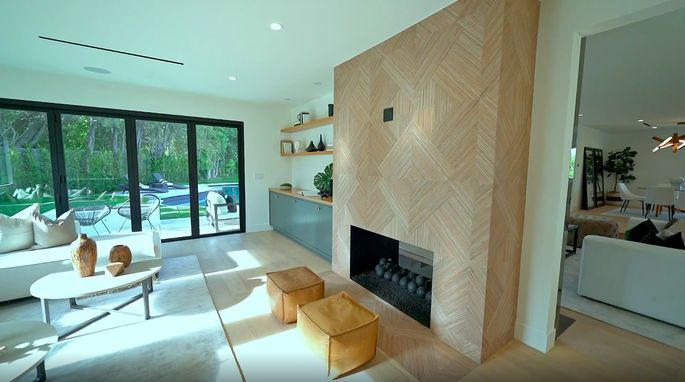 This fireplace gives a fun, fresh feel to one side of the living space.