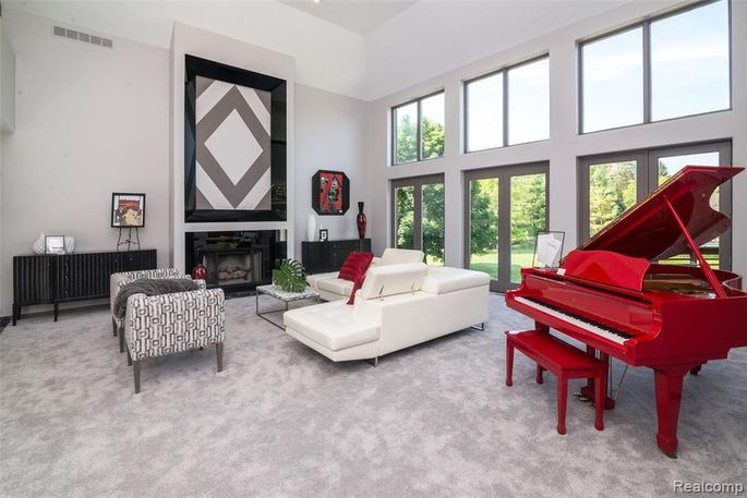 Living room with the singer's red piano