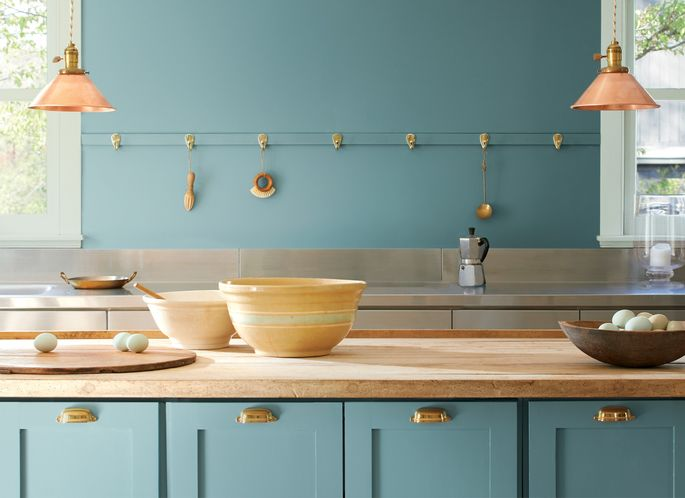 Blond wood and metallic accents play up the beauty of this quiet aqua.