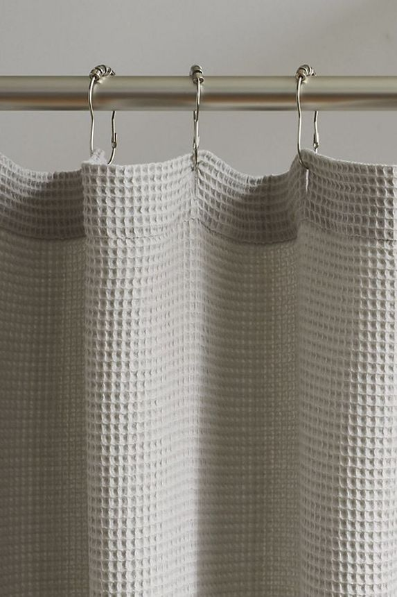 A cotton waffle shower curtain adds spa vibes.