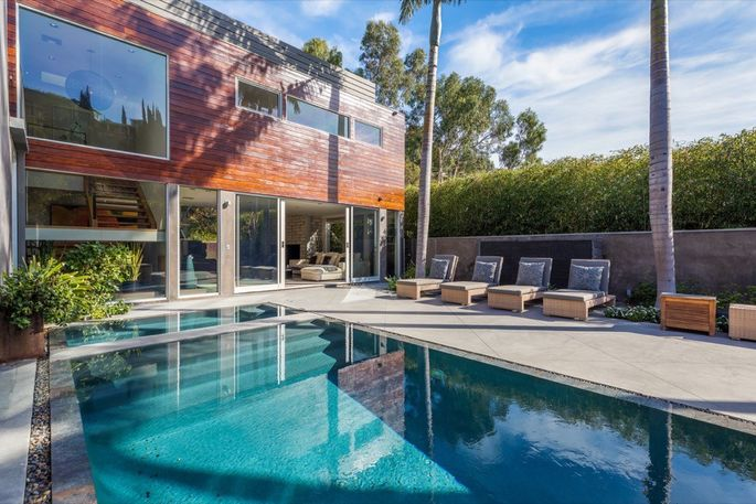 In addition to the zero-edge pool, the property features a spa and fire pit.