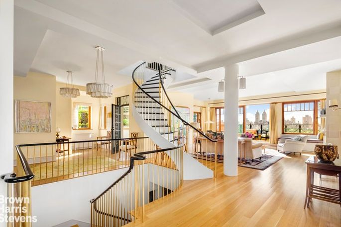 Three floors connected by curved staircases