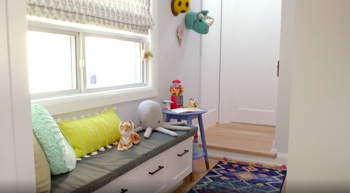 This playroom is a perfect spot to store toys!