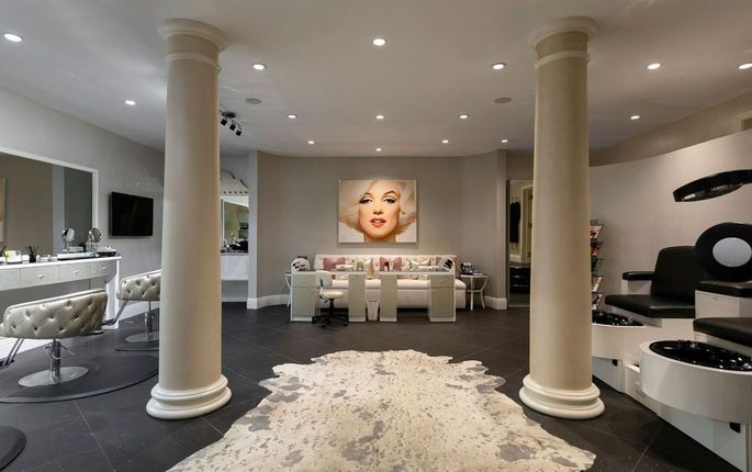 This beauty salon at Spelling Manor previously housed Candy Spelling's china doll collection.