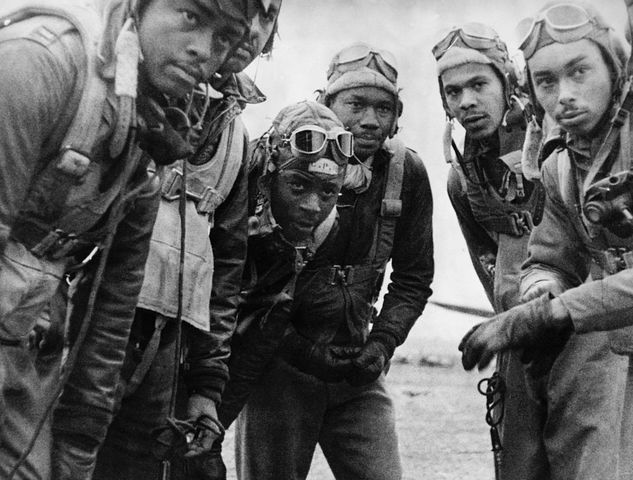 Black Americans, like these Tuskegee Airmen, served their country in World War II but returned home to face discrimination.