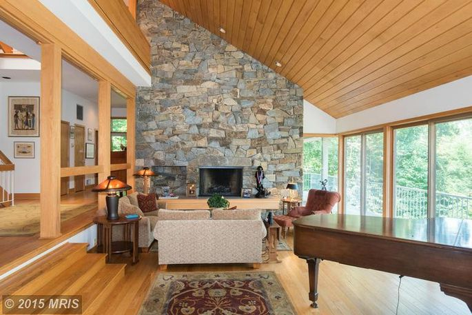 The Living Room With A Massive Stone Fireplace