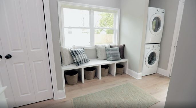 A mudroom can also function as a laundry room.