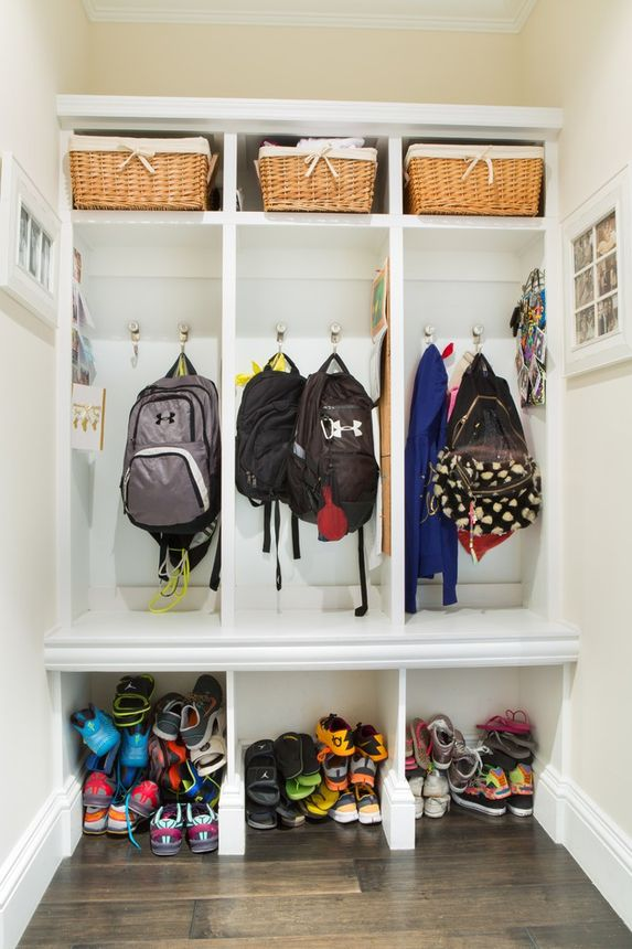 Giving kids their own storage space at an entry point helps keep comings and goings more efficient.