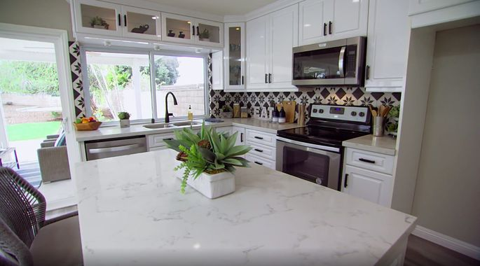 The new backsplash and hardware make these cabinets look new.