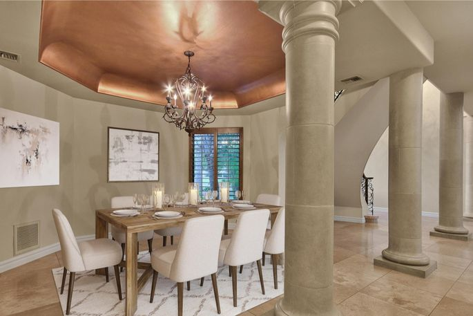 Greek columns add drama to the dining and living space.