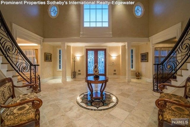 Entryway with double staircase