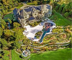 An Ode to Opulence, This $10M Mansion Has a Violin-Shaped Pool