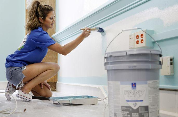 Fletcher gives a classroom a fresh coat of paint.