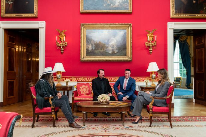 First lady Melania Trump has a meeting in the Red Room of the White House.