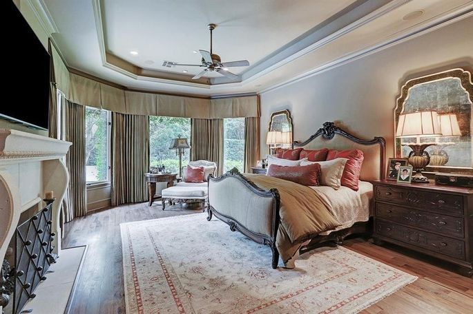 Master suite with bay window and fireplace