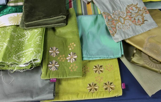 Samples of 38 throw pillow covers to be auctioned off
