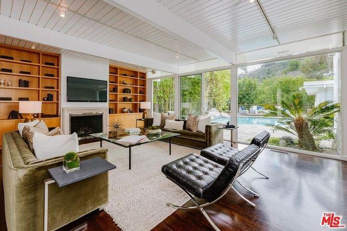 Living room with pool views