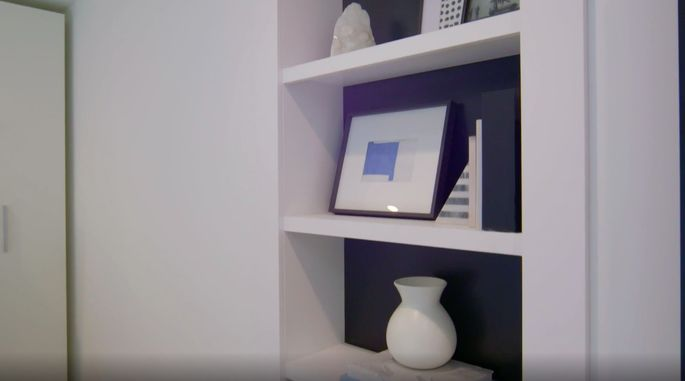 This may look like an unassuming bookshelf, but it's actually a secret closet!