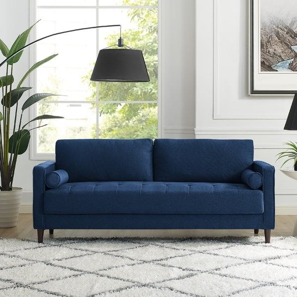 Make A Statement With A Sleek, Dark Blue Sofa.