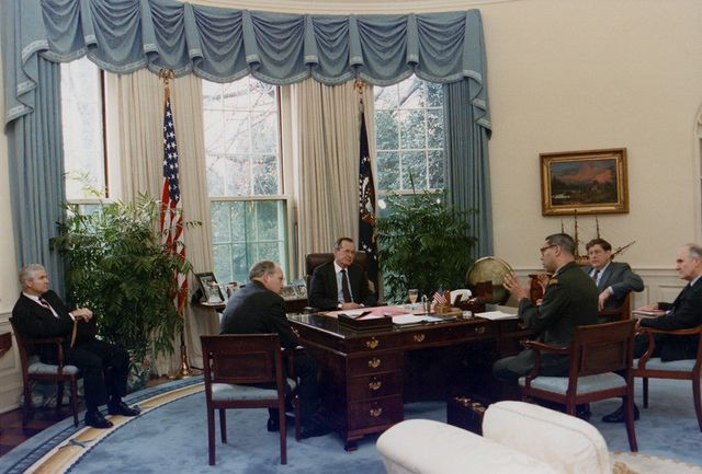 President George H.W. Bush meets with members of his Cabinet in the Oval Office.