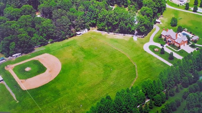 Backyard Baseball Fields hit a home run with this md mansion featuring a baseball diamond