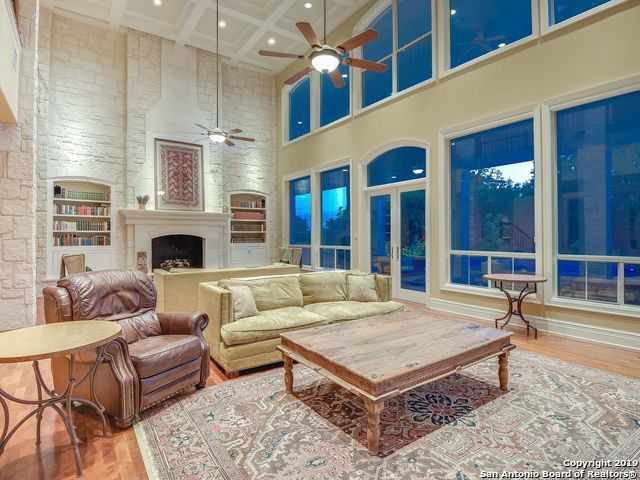 Living room with floor-to-ceiling windows and fireplace