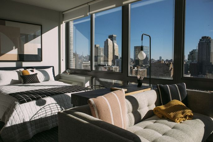 A studio apartment at 235 Grand Street with views of Manhattan.