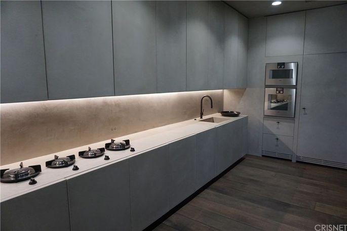 The kitchen features high-end appliances, including a Gaggenau oven, Sub-Zero refrigerator, and Bosch dishwasher.