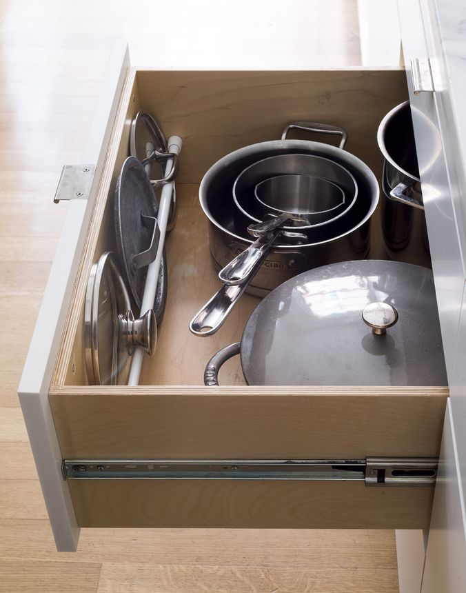 A simple dowel will help keep pot lids from getting mixed up with other cookware.