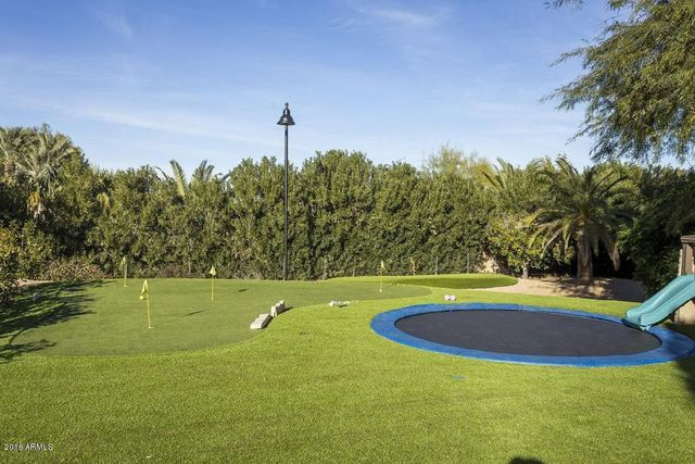 In-ground trampoline and putting course