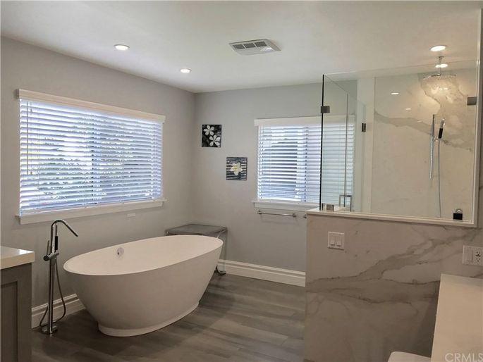 Calacatta marble slab shower and spa tub