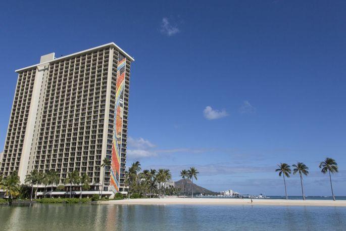 The Hilton Hawaiian Village Wakiki Beach resort stands next to the Duke Kahanamoku Lagoon in Honolulu, Hawaii.