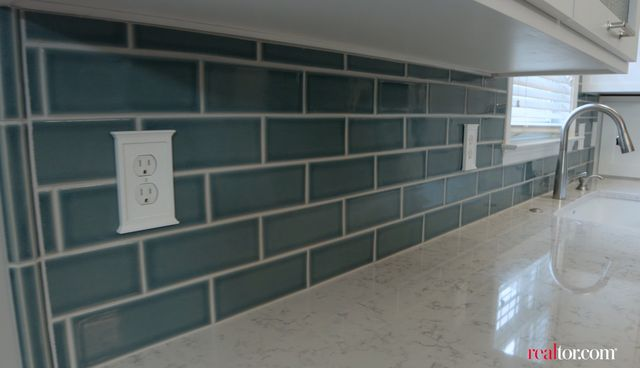 This teal backsplash provides a necessary pop of color.