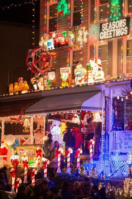 Gawkers check out the trains in one resident's display. Credit: Nate Pesce for The Wall Street Journal
