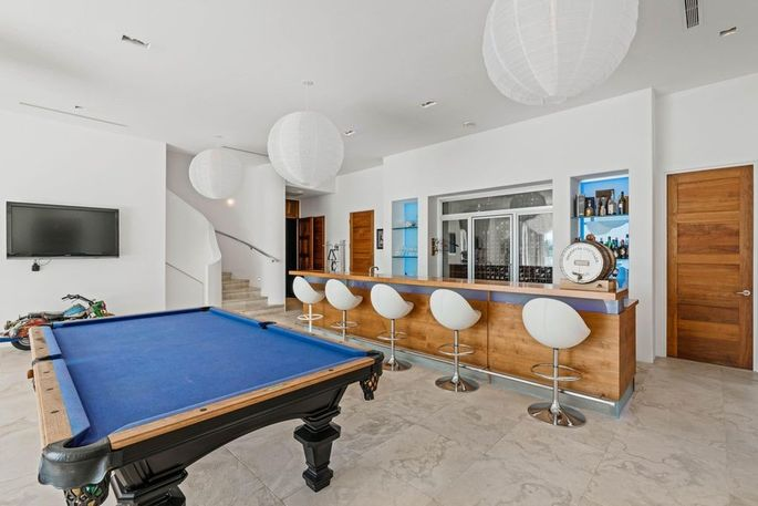 Entertainment room with bar and billiards