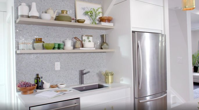 These floating shelves show off the kitchen backsplash.